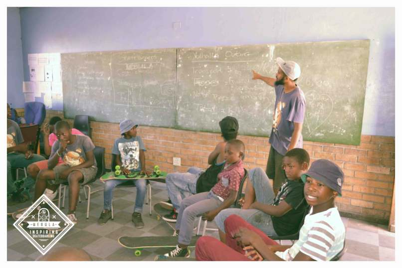 Teaching children in between skateboarding sessions